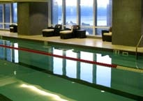 Trump International Hotel & Tower Chicago's heated indoor pool features windows, which showcase panoramic skyline views overlooking the Chicago River