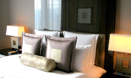 Soothing gray and cream tones in the guest room provide a warm welcome for hotel guests at Trump International Hotel & Tower Chicago