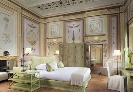 A guest room at Castello del Nero Hotel & Spa in Tuscany, Italy