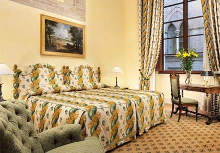 A guest room at Grand Hotel Continental Siena in Tuscany, Italy