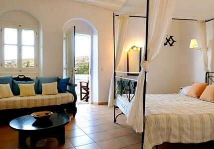 A guest room at Lefkes Village in Paros, Greece, one of GAYOT's Top 10 Value Hotels Worldwide
