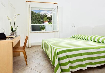 A guest room at La Tosca in Capri, Italy, one of GAYOT's Top 10 Value Hotels Worlwide