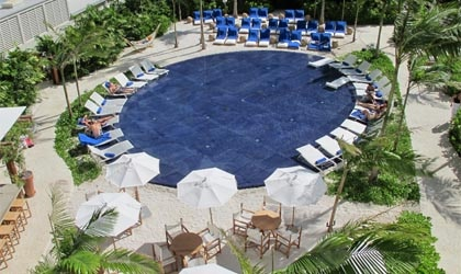 The Private Sunset Beach Pool at The Waikiki EDITION in Honolulu, Hawaii