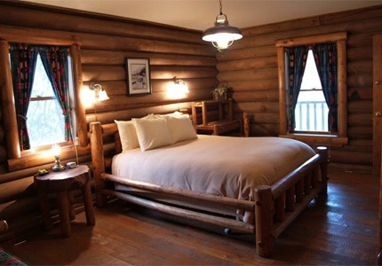 Stay in a cozy cabin at Red Horse Mountain Ranch
