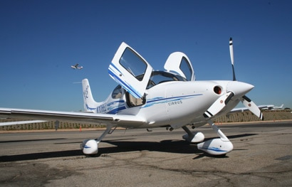 A three-quarter front view of a Cirrus SR22