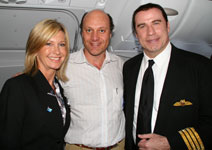 "Alain Gayot with reunited ""Grease"" co-stars Olivia Newton-John and John Travolta, in the cabin of the Qantas A380 aircraft"