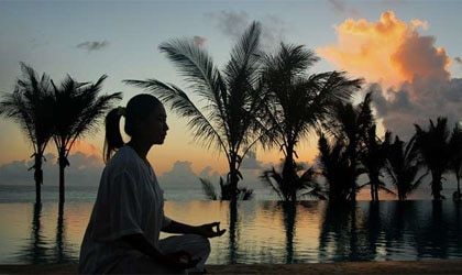 Yoga at the pool of Zamani Retreat Kempinski in Zanzibar, Africa