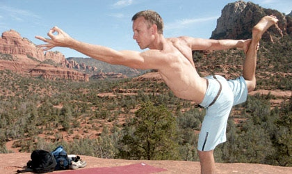 A man does a yoga pose at 7 Centers Yoga Arts in Arizona