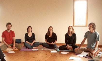 Guests practice breathing exercises and learn yoga theory at Clare Island Yoga Retreat Centre in Ireland