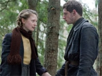Mia Wasikowska and Jamie Bell in Defiance