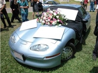 A General Motors EV1 at a funeral for electric cars staged by EV supporters