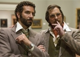 Bradley Cooper and Christian Bale in American Hustle, one of GAYOT's Top 10 Films of 2013