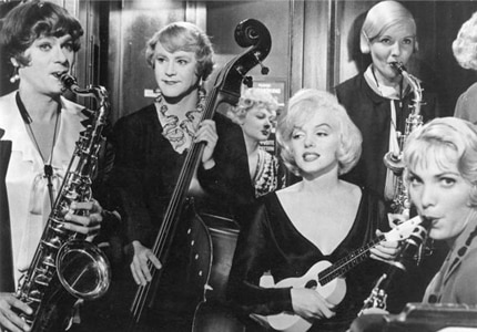 Tony Curtis, Jack Lemmon and Marilyn Monroe in the classic slapstick flick Some Like It Hot, featured on GAYOT.com's Top 10 Romantic Comedies