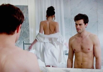 Jamie Dornan and Dakota Johnson in 50 Shades of Grey, one of GAYOT's Top 10 Sexy Movies