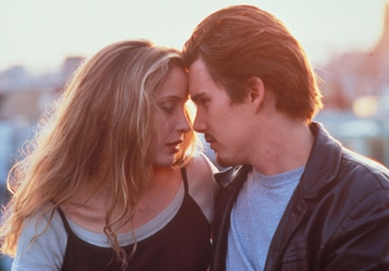 Ethan Hawke and Julie Delpy star in Before Sunrise, one of GAYOT's Top 10 Romantic Movies