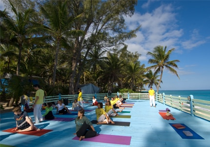 A yoga class at Sivananda Ashram Yoga Retreat in the Bahamas, one of GAYOT's Top 10 Yoga Retreats Worldwide