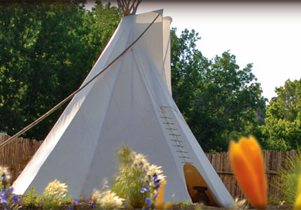Bond with nature in an Native American Teepee at The Bishop's Lodge Resort & Spa