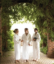 Three spa-goers on a stroll at The Spa of Colonial Williamsburg