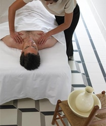 A man receives a massage at The Spa of Colonial Williamsburg