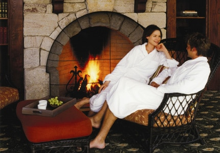 A couple relaxes by the fire at Mohonk Mountain House in New York