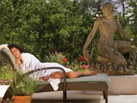 Lounging beside sculpture