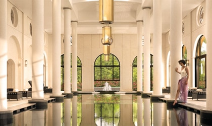 A serene pool surrounded by columns at Terre Blanche