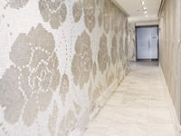 A floral hallway of mosaic tiles