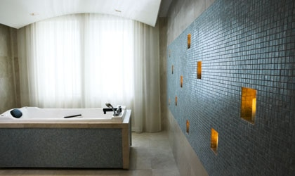 A wet room at Guerlain Spa, with floating rounded ceilings