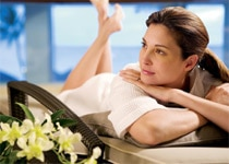 A woman relaxes in the spa's ocean view lounge