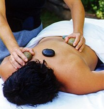 A guest receives the Ojai Hot River Rock massage at The Oaks at Ojai