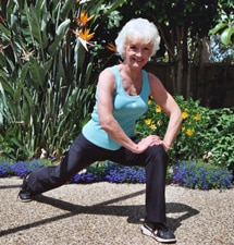 Sheila Cluff, founder and owner of The Oaks at Ojai, stretching