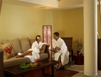 A couple relaxes at the Waikiki Plantation Spa