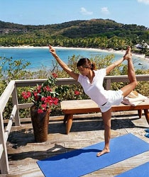 A woman poses on the Yoga Deck