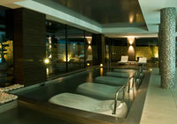One of the indoor pools at SHA Wellness Clinic in Alicante, Spain; it has molded beds for comfort