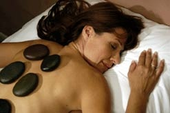 A woman receives a hot stone treatment at Deerfield Spa in East Stroudsburg, Pennsylvania