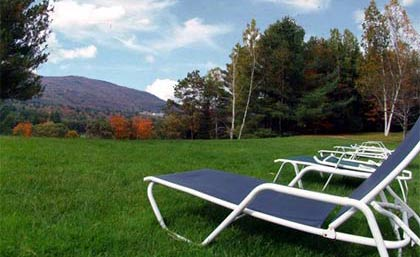 Relax with a view of the green scenery at Green Mountain at Fox Run in Ludlow, Vermont