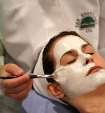 A woman receives a facial treatment at The Heartland Spa in Illinois