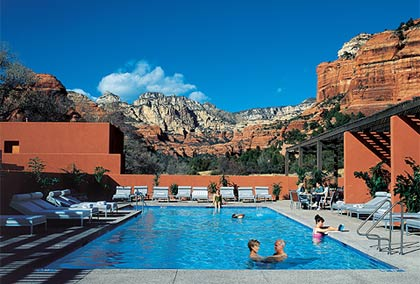 A couple lounges in a pool at Mii amo in Sedona, Arizona