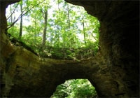 The world's largest double-span natural bridge is located on the property of the Tennessee Fitness Spa in Waynesboro, TN