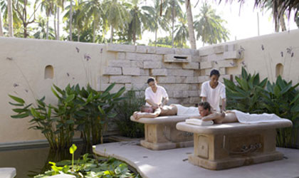 An outdoor couples massage at Six Senses Sanctuary Phuket in Thailand