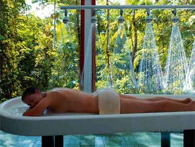 A woman receives a shower treatment at the Healing Waters Spa in Mossman, Australia
