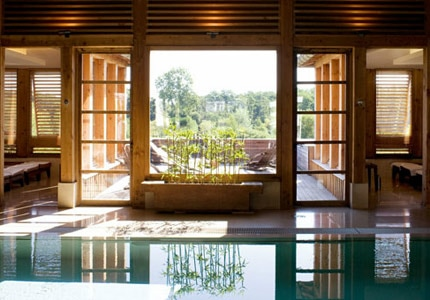 The serene main pool at the Vinotherapie Spa at Les Sources de Caudalie in Bordeaux, France