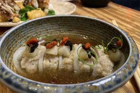 Dragon's Pearl: scallop & pork dumpling wrapped in daikon, mushroom broth & black moss