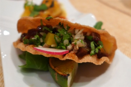 Among the Red Hour offerings at Crustacean are a beef taco in a wonton shell