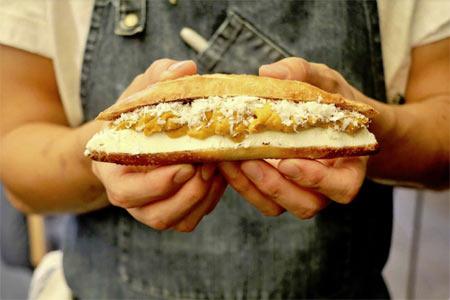 Chef Brandon Kida presents the uni baguette at Hinoki & the Bird