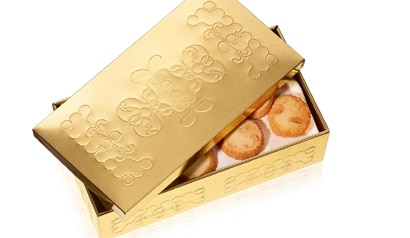 Golden cookie box from the line of gifts from chef Jean-Francois Piege