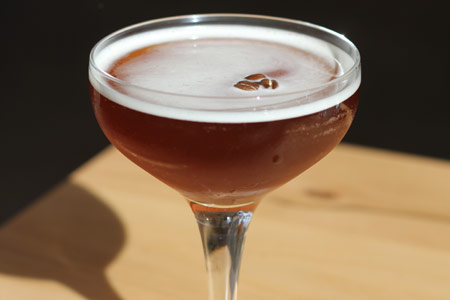 A cocktail by Julian Cox at Rose Café-Restaurant