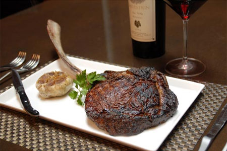 A bone-in ribeye from Red PrimeSteak in Oklahoma City, one of GAYOT's top spots for steak in the country