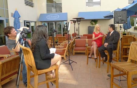 Sophie Gayot filming a video at JW Marriott Santa Monica Le Merigot