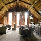 In Walland, TN, the magically lit, turn-of-the-century The Barn at Blackberry Farm pairs rustic romance and fine dining